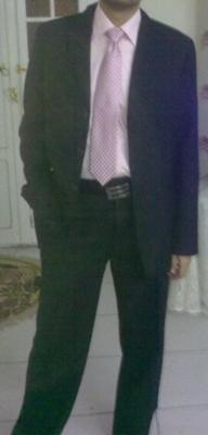 black suit, pink shirt, pink tie